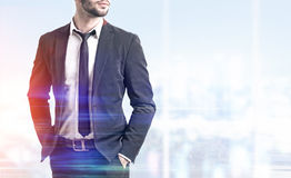 Close up of businessman in office and a city view Royalty Free Stock Photos