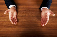 Close up of businessman open hands on the desk Royalty Free Stock Photo