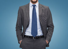 Close up of businessman over blue background Royalty Free Stock Images