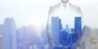 Close up of businessman over city background Royalty Free Stock Photo