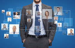 Close up of businessman over icons with contacts royalty free stock images