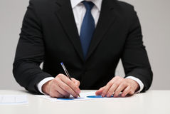 Close up of businessman with papers Stock Photos