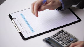 Close up of businessman with papers and calculator stock video footage