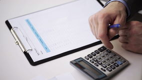 Close up of businessman with papers and calculator stock footage