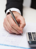 Close up of businessman with papers and calculator Royalty Free Stock Photography