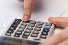 Close up of businessman with papers and calculator Stock Photography
