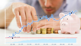 Close up of businessman with piggy bank and coins Stock Image