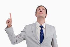 Close up of businessman pointing and looking up Stock Photo