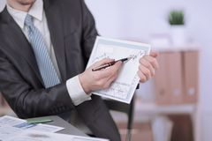 Free Close Up.Businessman Pointing Pencil On Financial Graph Stock Photography - 130992162