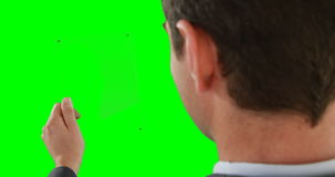 Close-up of businessman pretending to use digital tablet. On green background stock footage