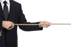 Close up of businessman pulling the rope Royalty Free Stock Images