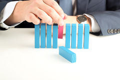 Close-up Of Businessman pushing out  wooden block Royalty Free Stock Images