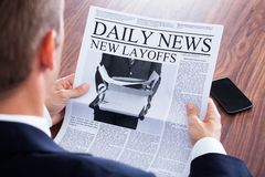 Close-up of businessman reading news Royalty Free Stock Photography