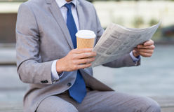 Close up of businessman reading newspaper Stock Photo