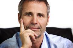 Close-up of businessman resting chin on hand. Stock Photos