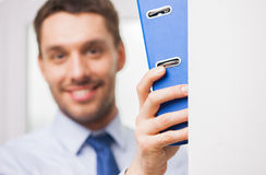 Close up of businessman with ring binder in office Stock Images