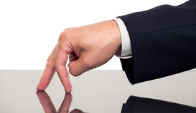 Close up of a businessman's fingers walking on a desk Royalty Free Stock Photos