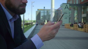 Close up businessman`s hand browsing smartphone, steadicam stock video