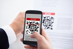 Close-up of businessman scanning a barcode Royalty Free Stock Photo