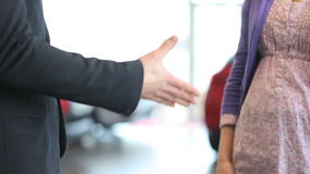 Close up of a businessman shaking hand of a woman stock footage