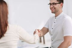 Close up.businessman shaking hands with his business partner. royalty free stock images