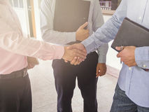 Close up of businessman shaking hands stock image