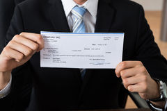 Close-up Of Businessman Showing Cheque Royalty Free Stock Photography