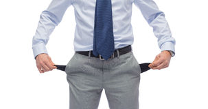 Close up of businessman showing empty pockets. Business, people, bankruptcy and failure concept - close up of businessman showing empty pockets Royalty Free Stock Photo