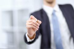 Close up.Businessman showing a pencil on the virtual point stock photo