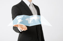 Close up of businessman showing world map Stock Image