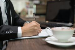 Close up businessman is signing a contract, business contract de. Tails at coffee shop Royalty Free Stock Photos
