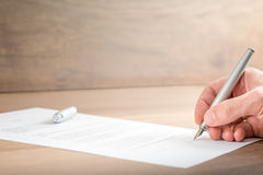Close up Businessman Signing a Contract Document Stock Images