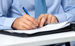 Close up of businessman signing a contract. Stock Photo