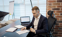 Close up businessman signing documents.Businessman is signing a royalty free stock photography