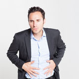 Close-up of businessman with strong stomach pain Stock Images