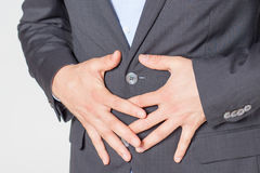 Close-up of businessman with strong stomach pain Royalty Free Stock Photography