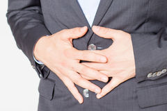 Close-up of businessman with strong stomach pain Stock Photos