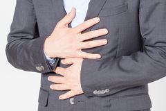 Close-up of businessman with strong stomach pain Stock Image