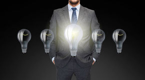 Close up of businessman in suit with ligh bulbs Royalty Free Stock Photo