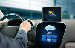 Close up of businessman with tablet pc driving car Stock Images