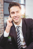 Close-up of businessman talking on mobile phone Royalty Free Stock Photo