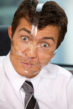 Close-up of businessman with tape on his face Stock Photos