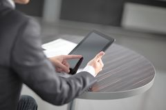 Close up. businessman tapping the screen of digital tablet royalty free stock photography