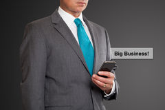Close up of businessman text messaging. On cell phone Stock Photo