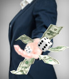Close up of businessman throwing dice and dollars. Stock Photos