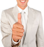 Close-up of a businessman with thumb up Stock Photo