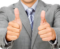 Close-up of a businessman with thumbs up stock photos