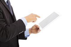 Close up of businessman touch tablet or ipad  in hand Stock Photo