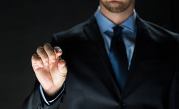 Close up of businessman touching virtual screen Royalty Free Stock Images