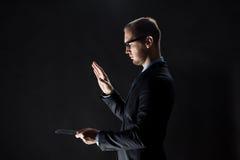 Close up of businessman with transparent tablet pc Stock Photos